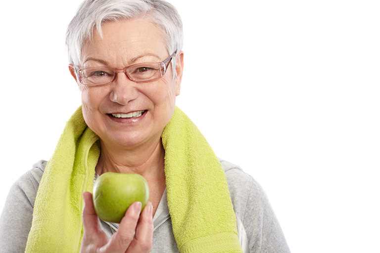 Older woman eating an apple